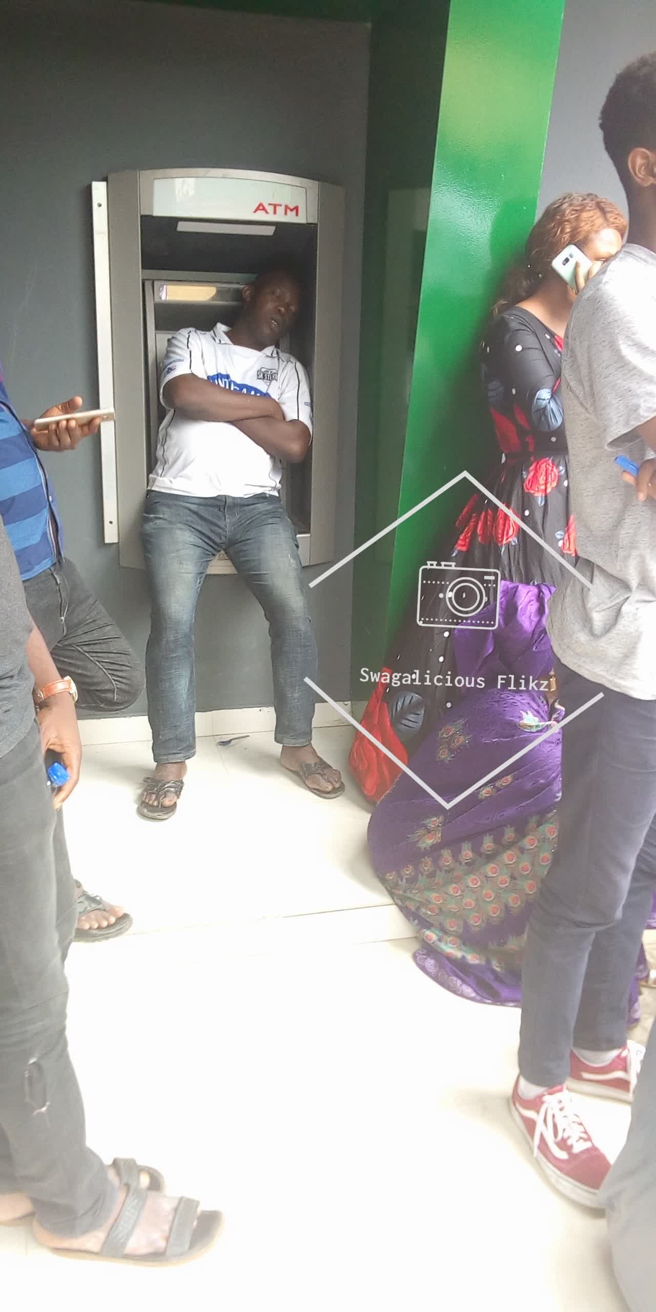 Man Sleeping On ATM At Immigration Office Ikoyi (Photo)